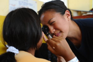 110501-F-CF975-092  PAITA, Peru (May 1, 2011) Lt. Patricia Salazar, an optometrist, examines the eyes of a patient at a medical clinic at Sagrado Corzon de Jesus School in Paita, Peru. Salazar is part of Continuing Promise 2011, a five-month humanitarian assistance mission to the Caribbean, Central and South America. (U.S. Air Force photo by Senior Airman Kasey Close/Released)